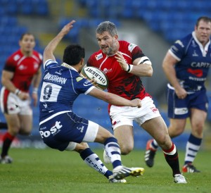Wily old head: Welsh captain Tom May on the charge